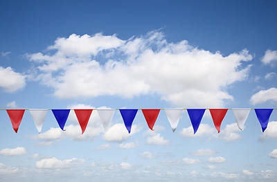 Red, White And Blue Bunting Against A Blue Sky Print by Jon Boyes