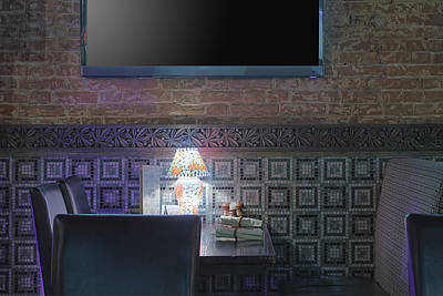 Restaurant Table With Lamp Under Tv Print by Magomed Magomedagaev