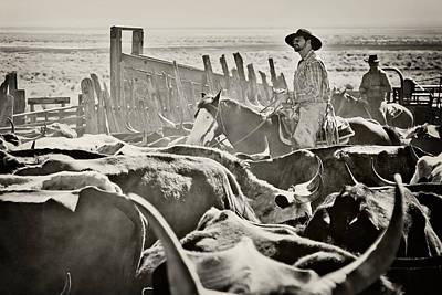 Riding Through The Herd Print by Megan Chambers