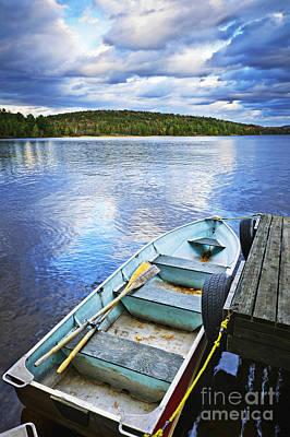 Ties Photograph - Rowboat Docked On Lake by Elena Elisseeva