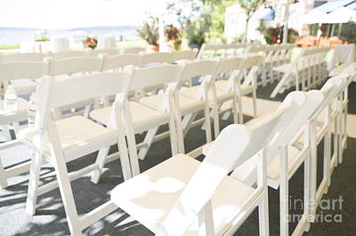 Rows Of White Folding Chairs Print by Ned Frisk