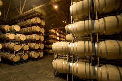 Rows Of Wine Barrels Stacked Print by Phil Schermeister