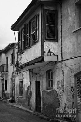 run down building with bay window in the old town of nicosia TRNC turkish republic northern cyprus Print by Joe Fox