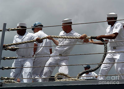 Sailors Heave Around On A Mooring Line Print by Stocktrek Images
