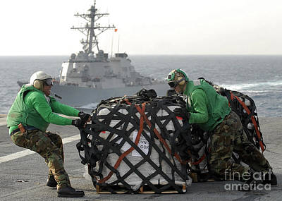 Sailors Move Supplies On The Flight Print by Stocktrek Images
