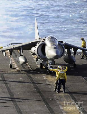 Av-8b Photograph - Sailors Prepare To Launch An Av-8b by Stocktrek Images