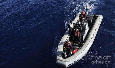 Rigid Hull Inflatable Boats Photograph - Sailors Stand Watch On A Rigid-hull by Stocktrek Images