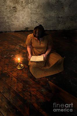 Schoolgirl Sitting On Wood Floor Reading By Candlelight Print by Jill Battaglia