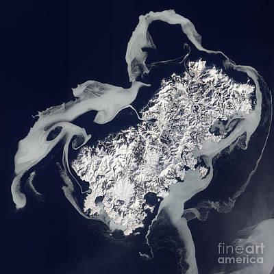 Landmass Photograph - Sea Ice Surrounds The Volcanic Island by Stocktrek Images