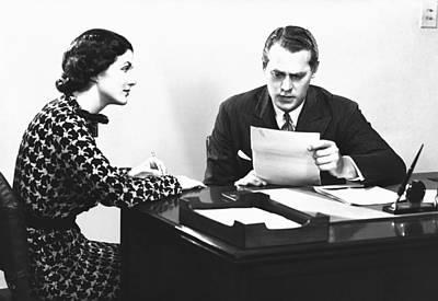 Secretary Assisting Businessman Reading Document At Desk, (b&w) Print by George Marks