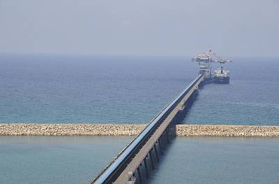 Ship Unloads Coal At The Pier Print by Photostock-israel