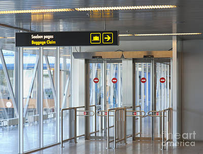 Sign Leading To Baggage Claim Print by Jaak Nilson