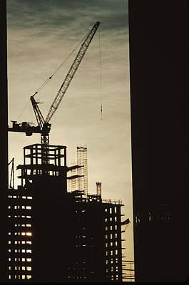 Cranes And Derricks Etc Photograph - Silhouette Crane At A Skyscraper by Ira Block