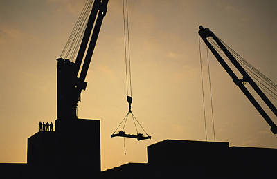 Cranes And Derricks Etc Photograph - Silhouette Of Cranes And Workers by Joel Sartore