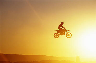 Silhouette Of Motocross Race In Mid Air, Sunset, Side View Print by John P Kelly