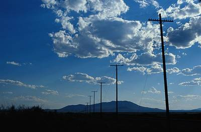 Telephone Poles Photograph - Silhouetted Telephone Poles Under Puffy by Raymond Gehman