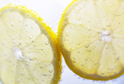Lemon Photograph - Slices Of Lemon In Sparking Water by Louise Geoghegan