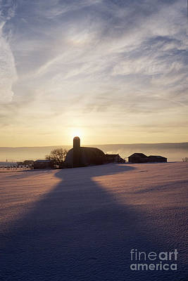Snow Covered Field With Farm Silhouette At Sunset Print by Jeremy Woodhouse