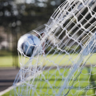 Soccer Ball In Goal Netting Print by Jetta Productions, Inc