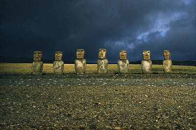 Carving In Stone Photograph - Stone Survivors Of A Lost Culture Stare by Thomas J. Abercrombie