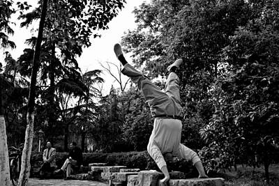 Yoga Photograph - Street Scene 1 - Chinese Upside Down In The Park Guy by Dean Harte