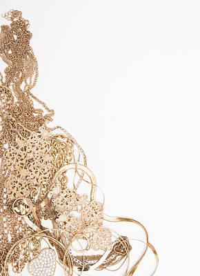 Studio Art Jewelry Photograph - Studio Shot Of Gold Jewelry by Vstock LLC