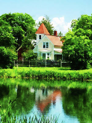 Suburban House With Reflection Print by Susan Savad