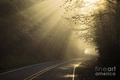 Sun Rays On Road Print by Ron Sanford and Photo Researchers