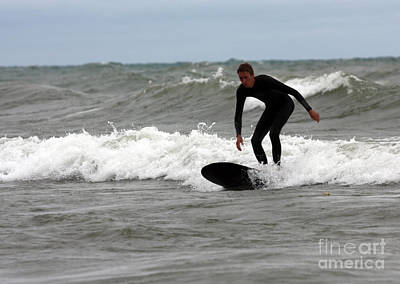 Surfers Photograph - Surfing Balancing At The End Of A Wave In Lake Michigan by Christopher Purcell