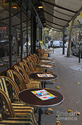 Tables Outside A Paris Bistro On An Autumn Day Print by Louise Heusinkveld