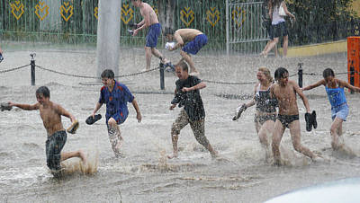 Flooding Photograph - Teenagers Playing In Floodwaters by Ria Novosti