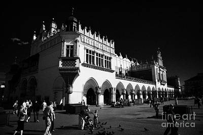 Polish City Photograph - The 16th Century Cloth Hall Sukiennice Building With Tourists In Rynek Glowny Town Square Krakow by Joe Fox