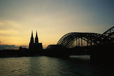 Sunset At The Bridge Photograph - The Cologne Cathedral And Hohenzollern by Raul Touzon
