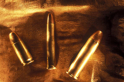 Three Golden 38 Calibre Bullets Print by Lyle Leduc