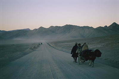 Transportation Of Goods Photograph - Tibetan Travelers On Their Way by Maria Stenzel