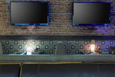 Tvs On Brick Wall In Restaurant Print by Magomed Magomedagaev
