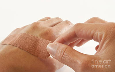 Two Hands With Bandage Print by Blink Images