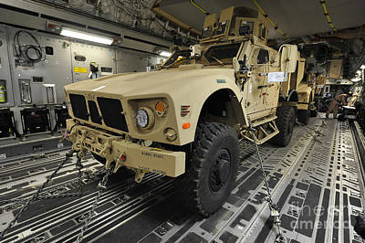 Armored Fighting Vehicles Photograph - Two M-atvs Await Transport On A C-17 by Stocktrek Images