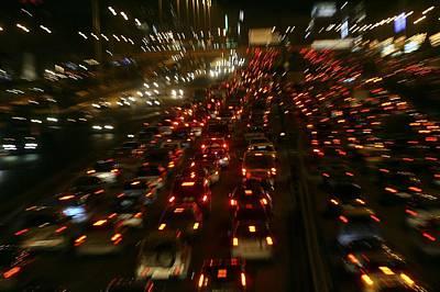 Gridlock Photograph - Urban Traffic Jams At Night by Ria Novosti