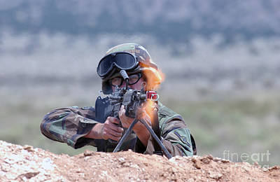 U.s. Air Force Airman Fires An Fnmi Print by Stocktrek Images