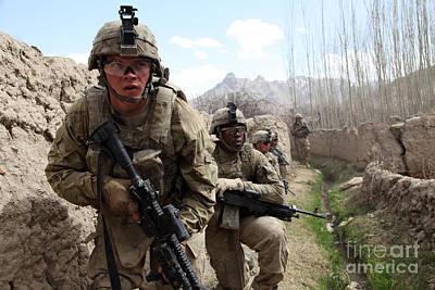 U.s. Army Platoon Moves In Behind Mud Print by Stocktrek Images