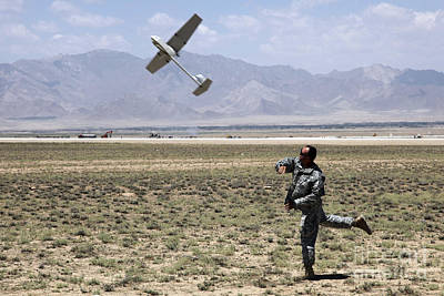 U.s. Army Soldier Launches An Rq-11 Print by Stocktrek Images