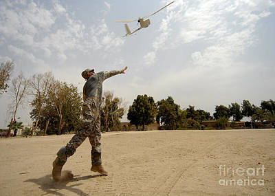U.s. Army Soldier Launches An Rq-11b Print by Stocktrek Images