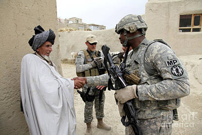 U.s. Army Soldier Shakes Hands With An Print by Stocktrek Images