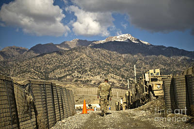 U.s. Army Soldier Walks Down A Path Print by Stocktrek Images