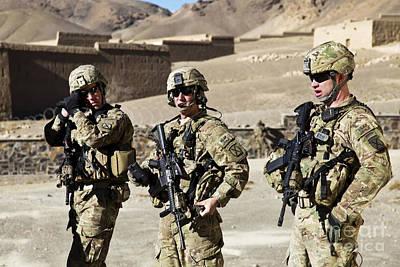 U.s. Army Soldiers Coordinate Security Print by Stocktrek Images