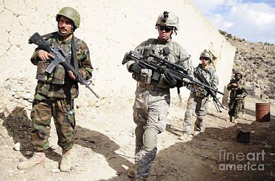 U.s. Army Troops Lead A Patrol Print by Stocktrek Images