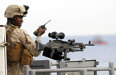 U.s. Marine Talks On A Radio While Print by Stocktrek Images