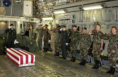 Terrorism Photograph - U.s. Military Personnel Salute The Flag by Everett