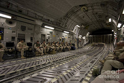 Passenger Plane Photograph - U.s. Soldiers Relax During A Flight by Terry Moore